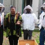 Trainees from Ethiopia along with CIP executive director, Palamattam, on a study-visit to a bee farm